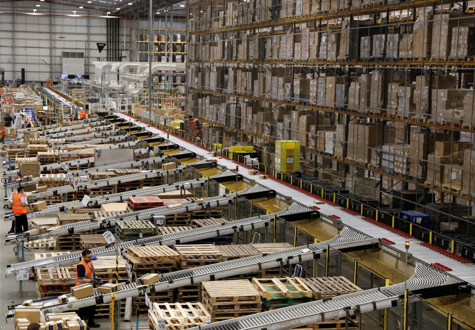 Workers sort parcels at Amazon's fulfilment centre in Peterborough