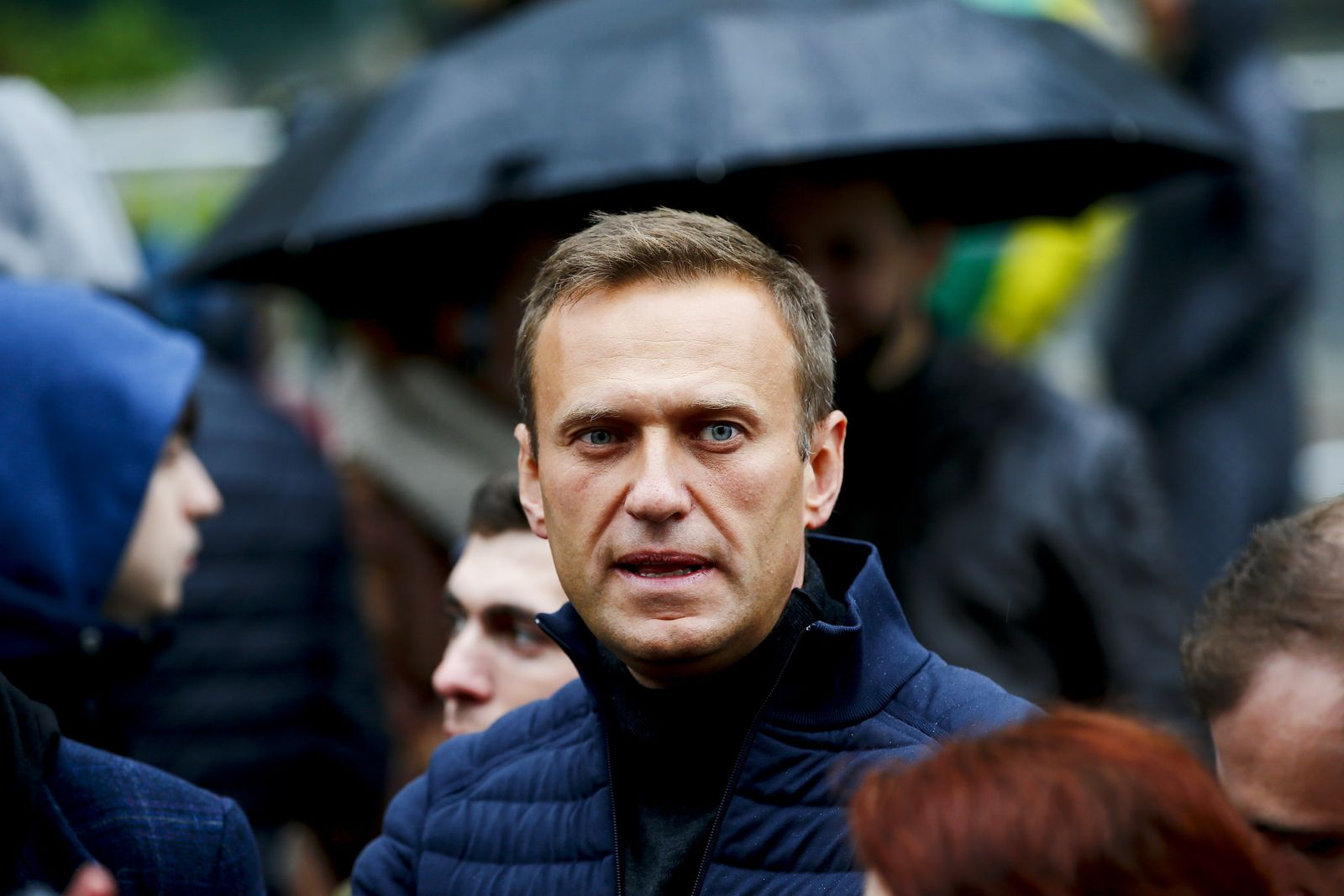 Alexei Navalny unconscious in hospital with suspected poisoning