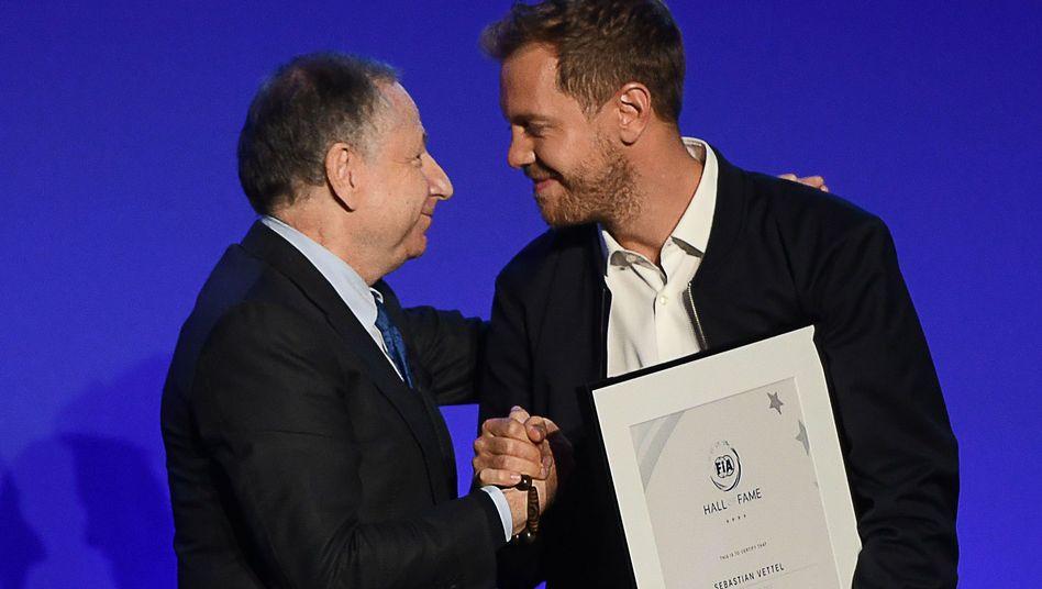 Jean Todt (l.), Sebastian Vettel (r.)