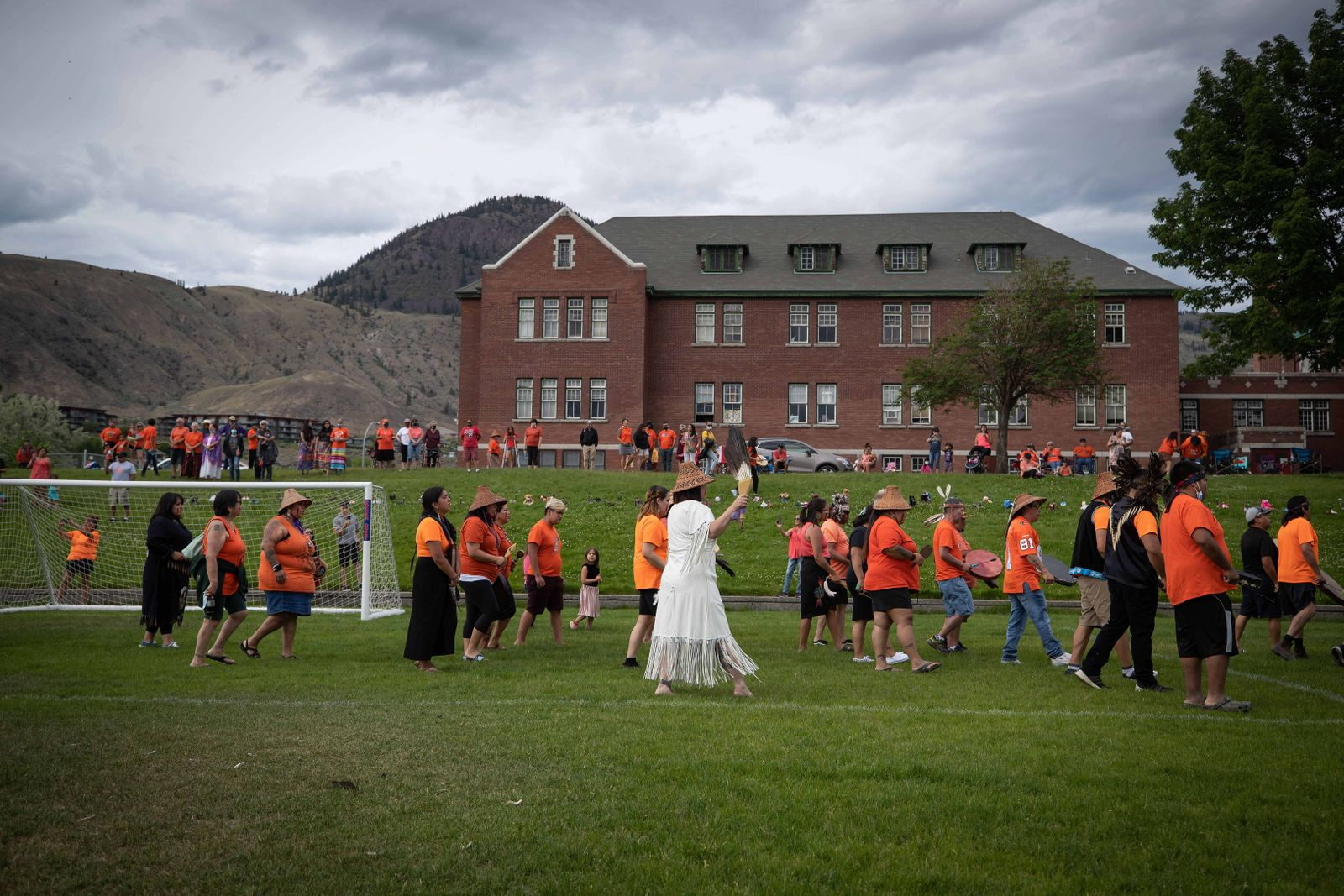 May 31, 2021, Kamloops, BC, Canada: People from the Sto:lo Nation march sing and drum as they march during a ceremony to