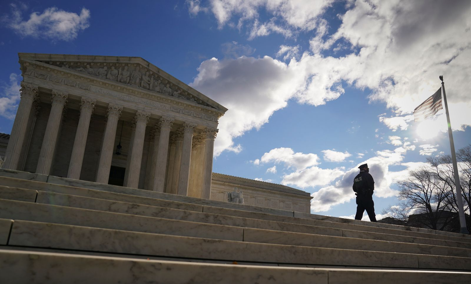 A police officer patrols in front of the U.S. Supreme Court in Washington