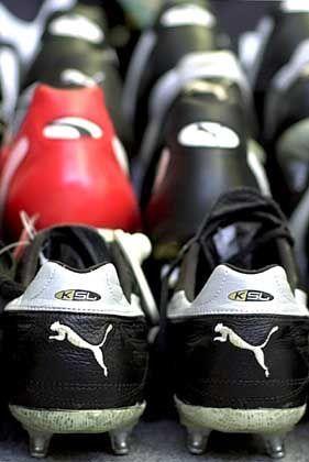 Fußballschuhe von Puma: Die Kaufzurückhaltung der Kunden betrifft offenbar nicht alle Konsumgüter gleichermaßen