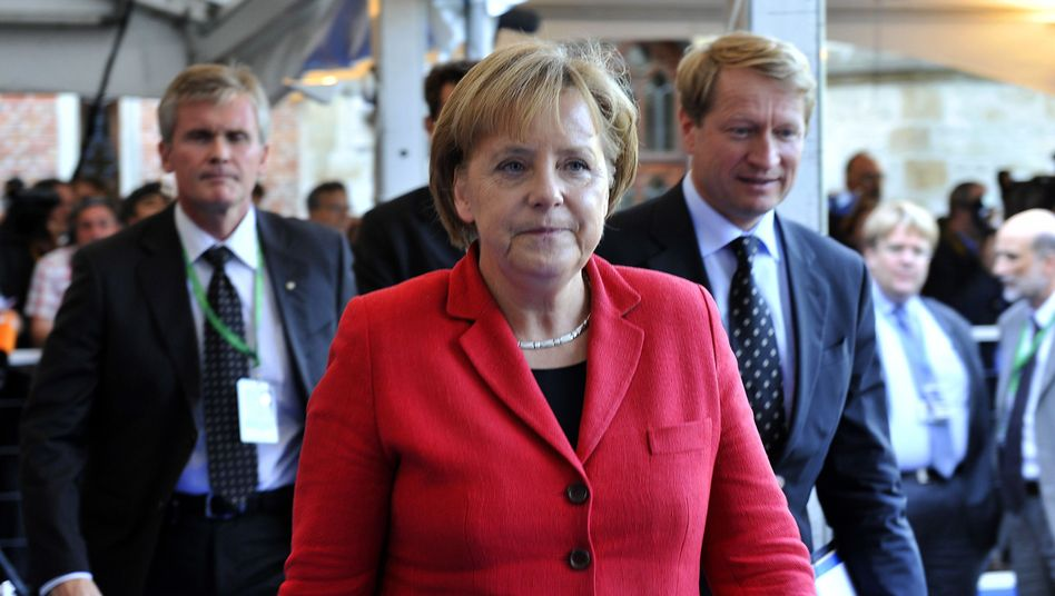 Sleeves rolled up? German Chancellor Angela Merkel in Brussels for the EU summit.