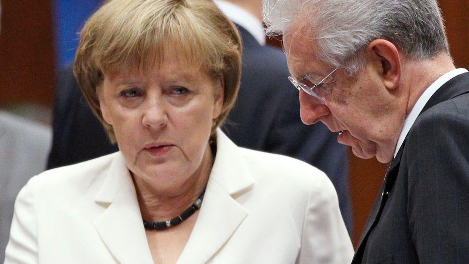 Angela Merkel mit Mario Monti: Entscheidend ist der Blick aufs Kleingedruckte