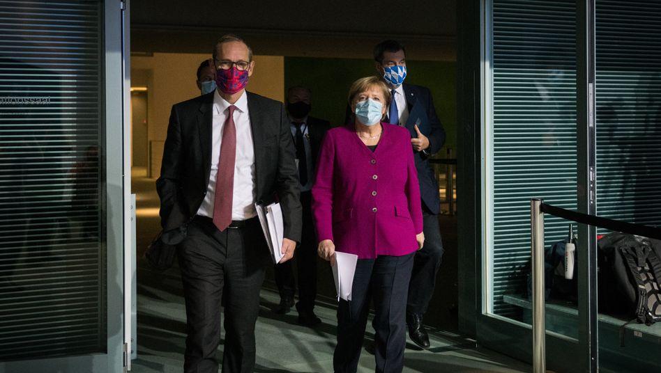 Berlins Regierender Bürgermeister Müller, Kanzlerin Merkel, Bayerns Ministerpräsident Söder