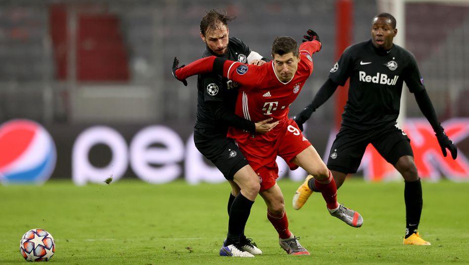 Robert Lewandowski (m.) traf zur Münchner Führung