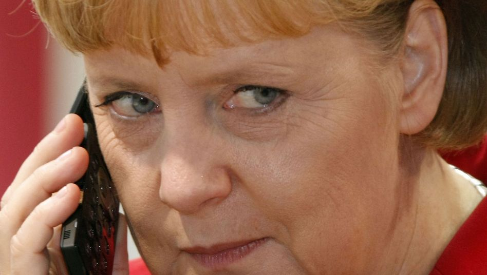 German Chancellor Angela Merkel has called for a halt to payments from India to an Iranian bank through Germany's central bank.