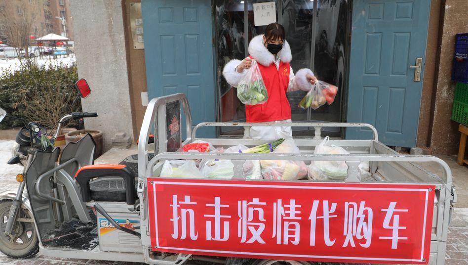 Einkäufe in China: Mehr als 30.000 Menschen sind infiziert