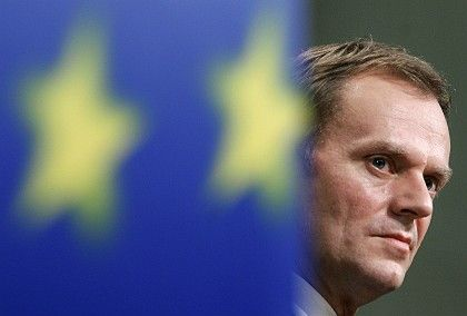 Poland's new center-right prime minister, Donald Tusk, pledged allegiance to the European flag on Tuesday.