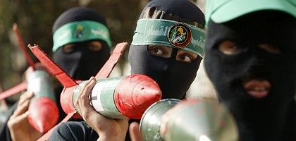Masked Palestinians take part on an anti-Israel rally organised by Hamas in the Gaza Strip.