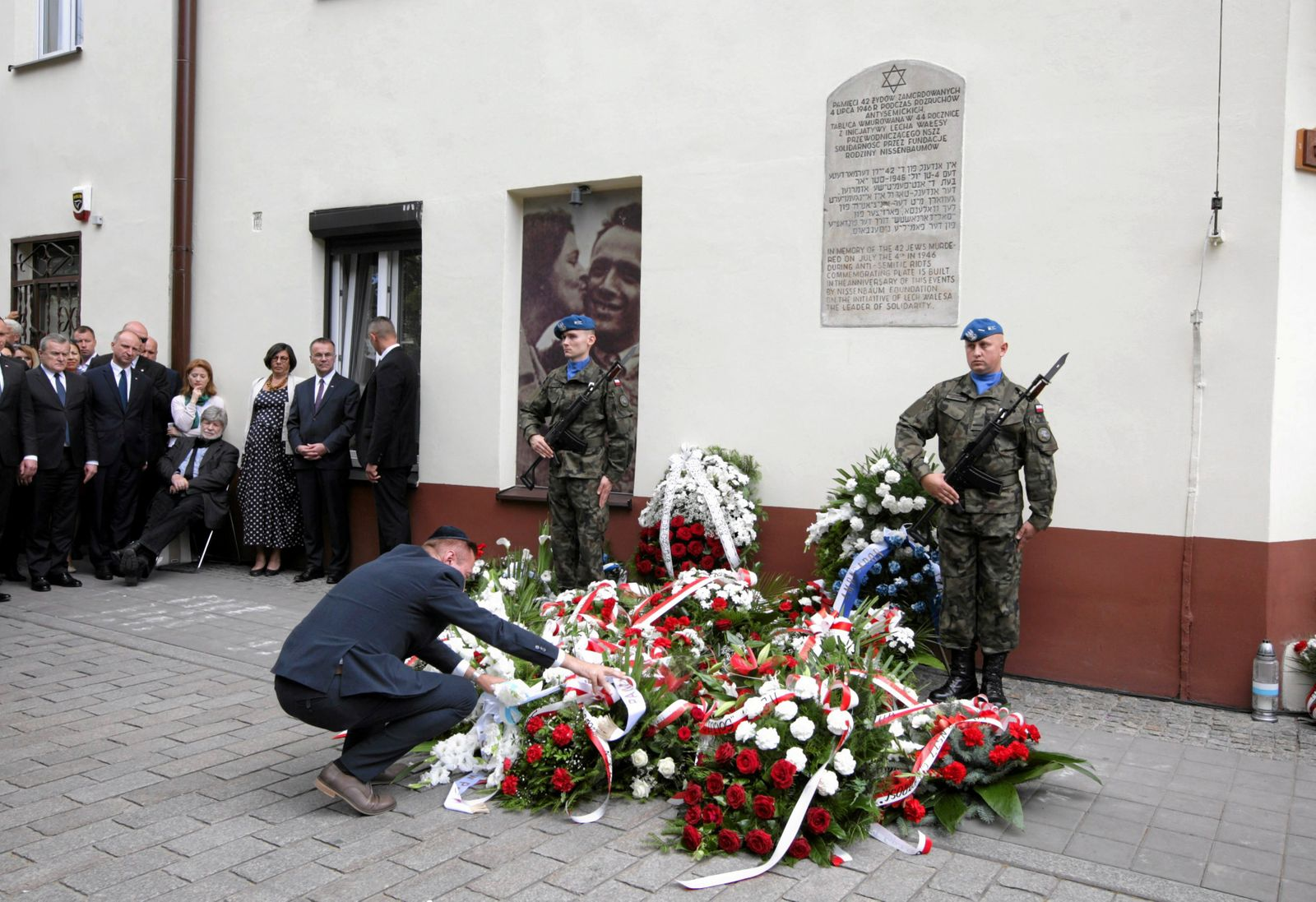 Officials take part in the ceremony to commemorate 70th anniversary of a 1946 massacre of Jews in Kielce