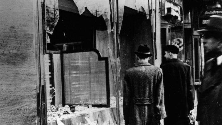 Broken windows of a Jewish shop on the morning after a Nazi pogrom on Nov 9, 1938.
