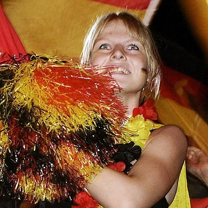 Rush of hormones: A German fan celebrating during last year's World Cup.