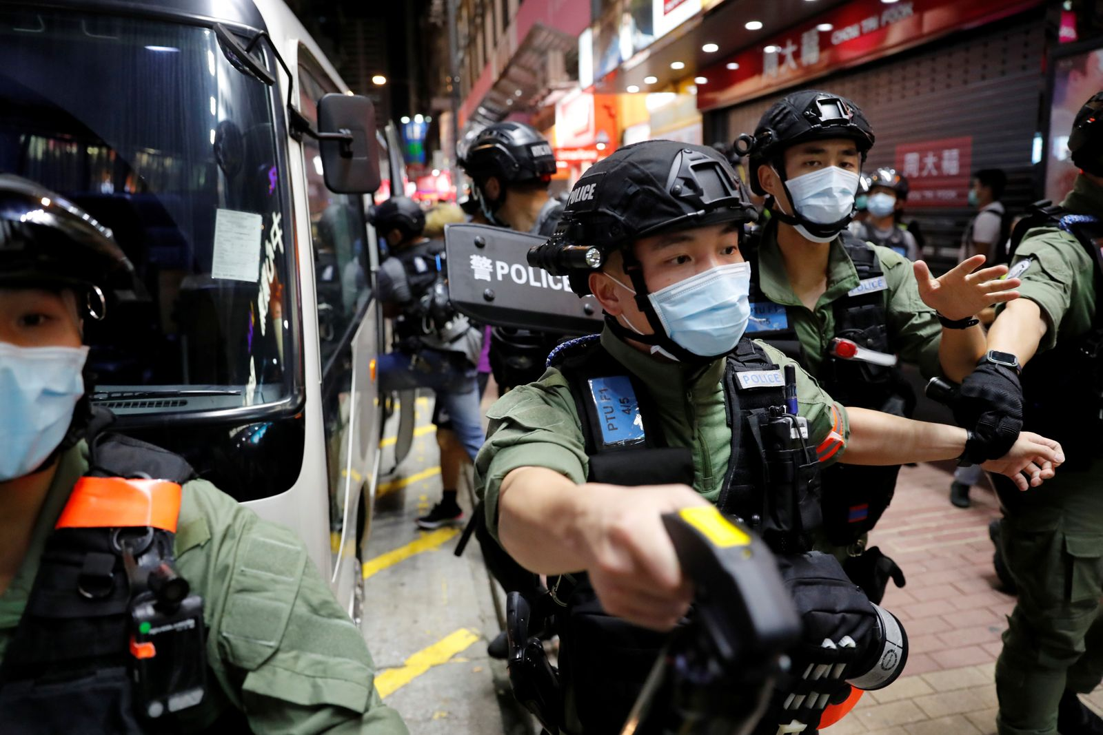 Riot police disperse pro-democracy protesters during a demonstration opposing postponed elections, in Hong Kong