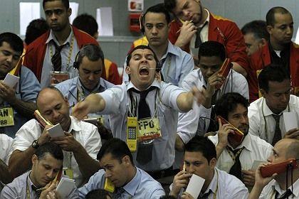 Stock traders negotiate in Sao Paulo, Brazil.