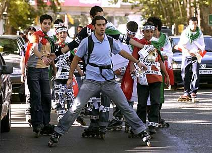 Young supporters of former Iranian President and presidential candidate Akbar Hashemi Rafsanjani, skating in the streets of Tehran.
