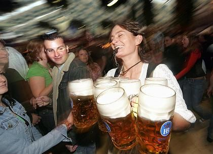 "A waitress hauling ""Mass"" or one-liter glasses of beer during last year's Oktoberfest."
