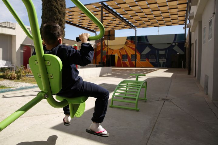 A migrant child exercises in a recreation area at the Noemi Alvarez Quillay immigrant shelter.