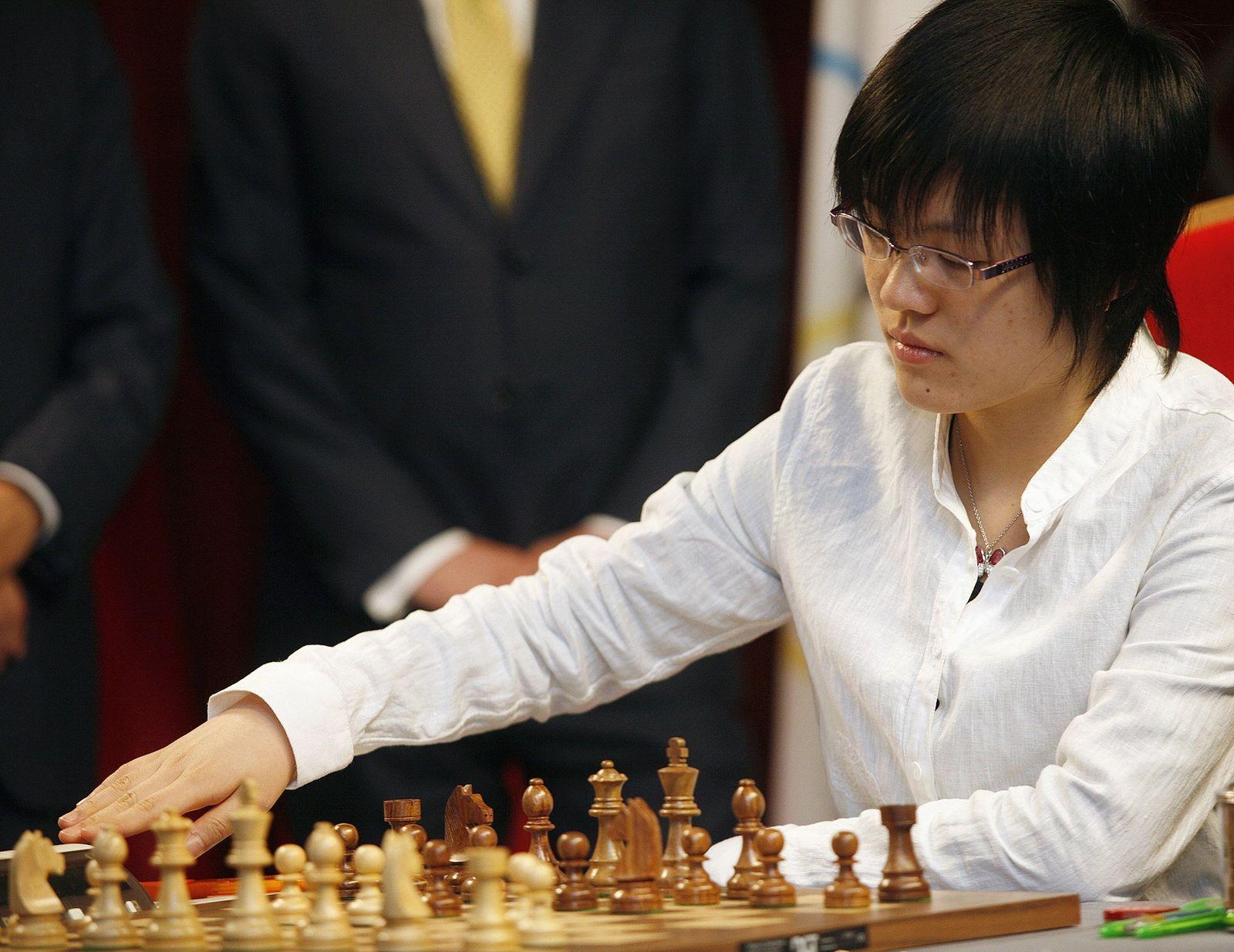 China's grandmaster Hou makes a move during her game against India's grandmaster Koneru in Tirana