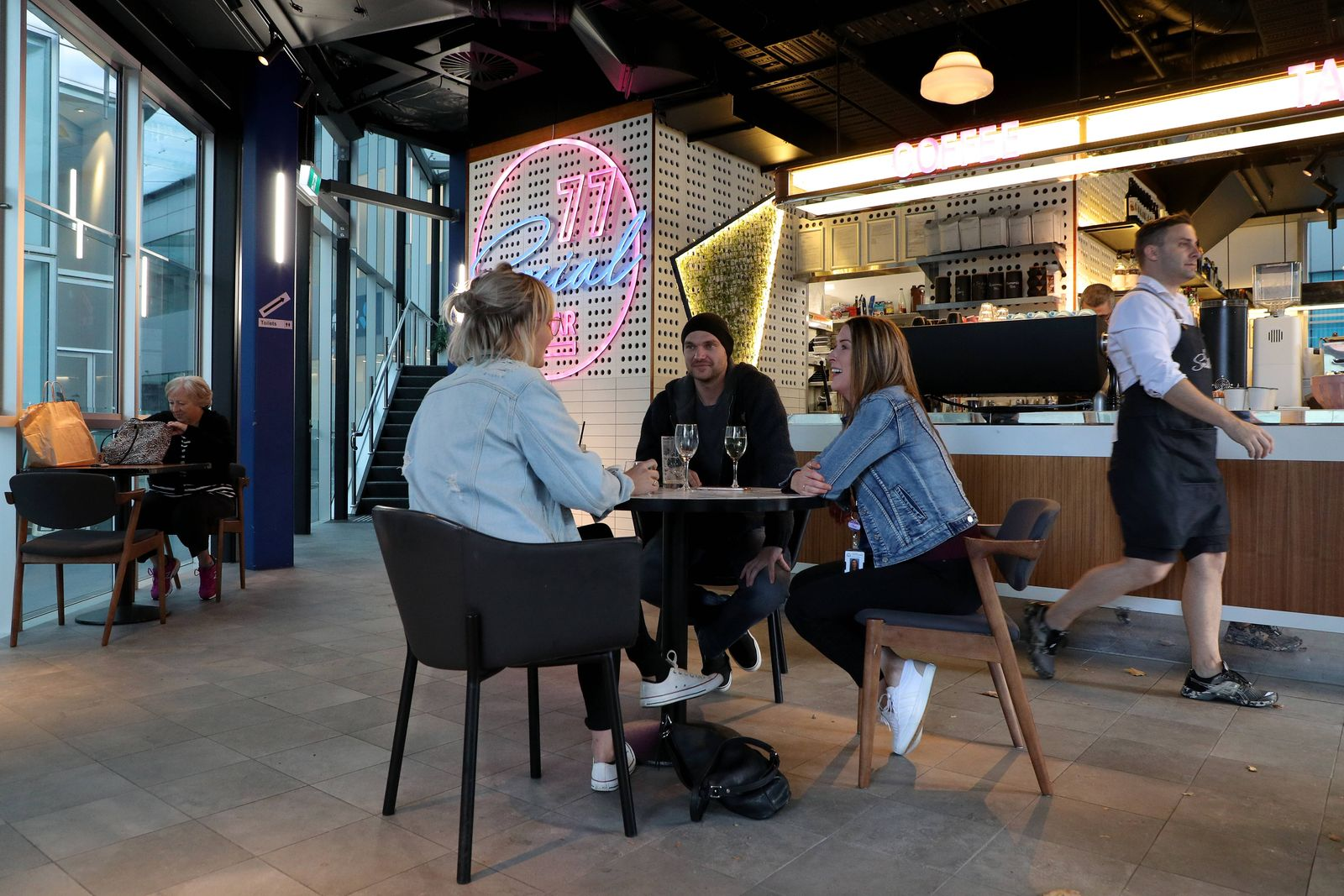 COVID-19 RESTRICTIONS EASED WA, Cafe goers are seen sitting in socially distanced tables in Perth, Monday, May 18, 2020