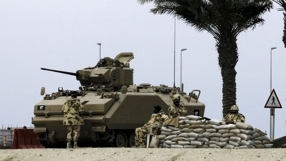 A tank guards a Bahrain harbor during unrest there in March 2011.
