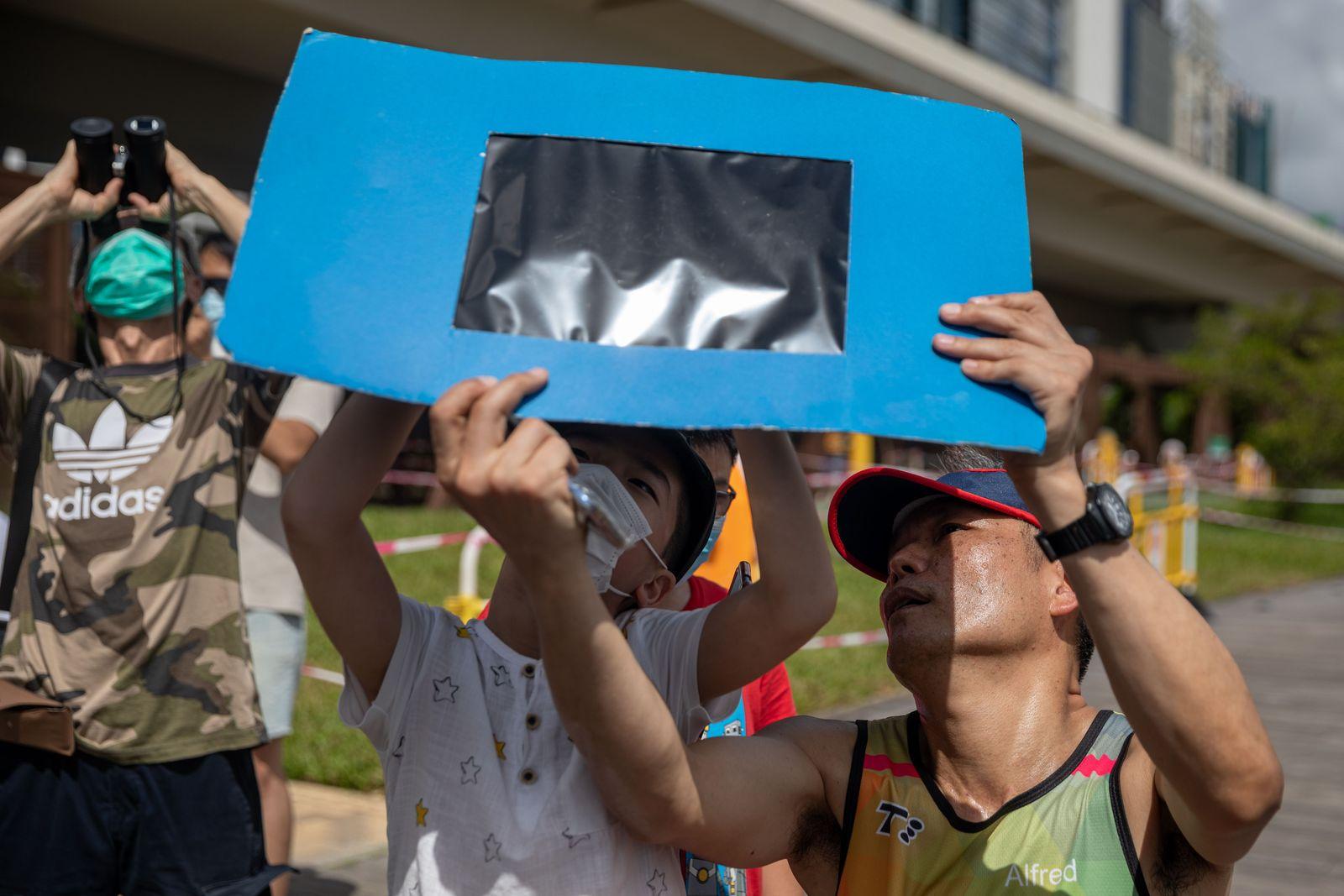 Partial solar eclipse in Hong Kong, China - 21 Jun 2020