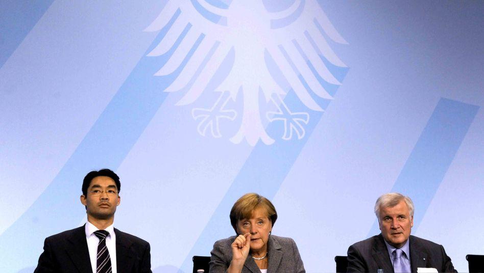 Koalitionäre Rösler, Merkel, Seehofer: Ein bisschen die Steuern senken