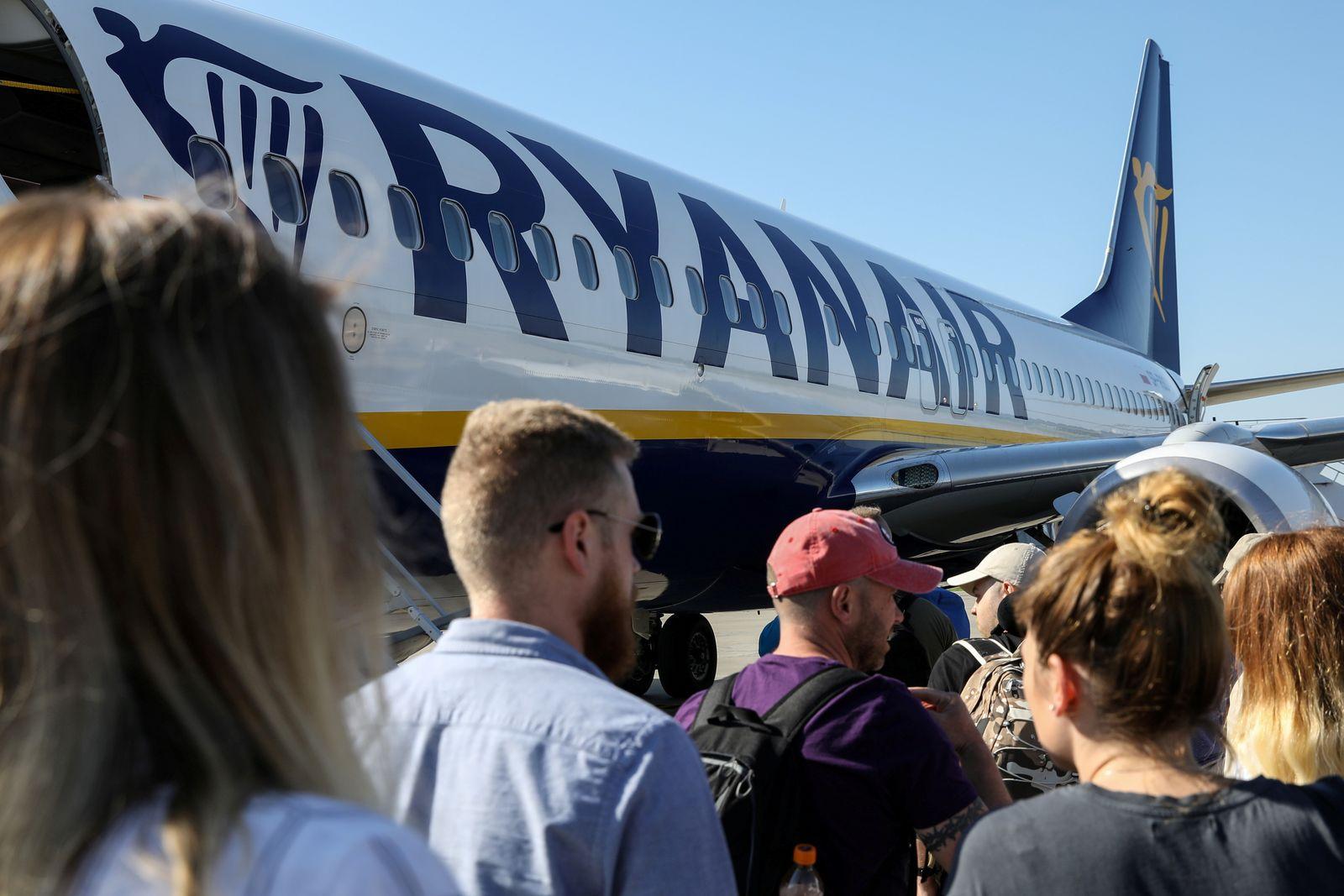 FILE PHOTO: Passengers board a Ryanair flight in Gdansk, Poland