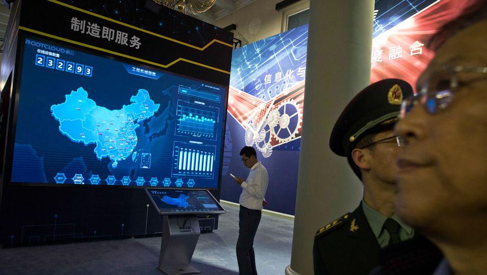 Ausstellung über Xi Jinping in Peking (Archivbild): Zählt auch Wirtschaftsspionage zu seiner Amtszeit?