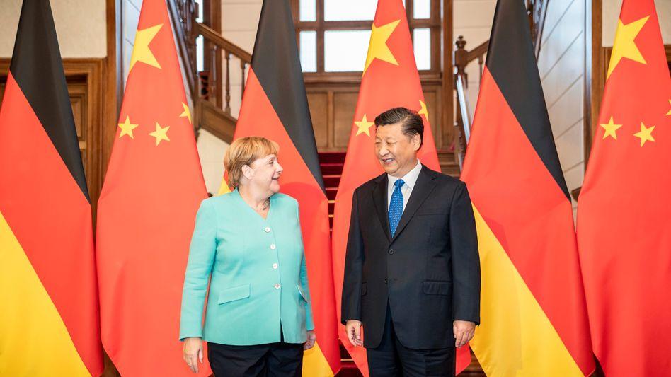 Während ihres letzten Chinabesuchs 2019 trifft Angela Merkel mit Staats- und Parteichef Xi Jinping zusammen.