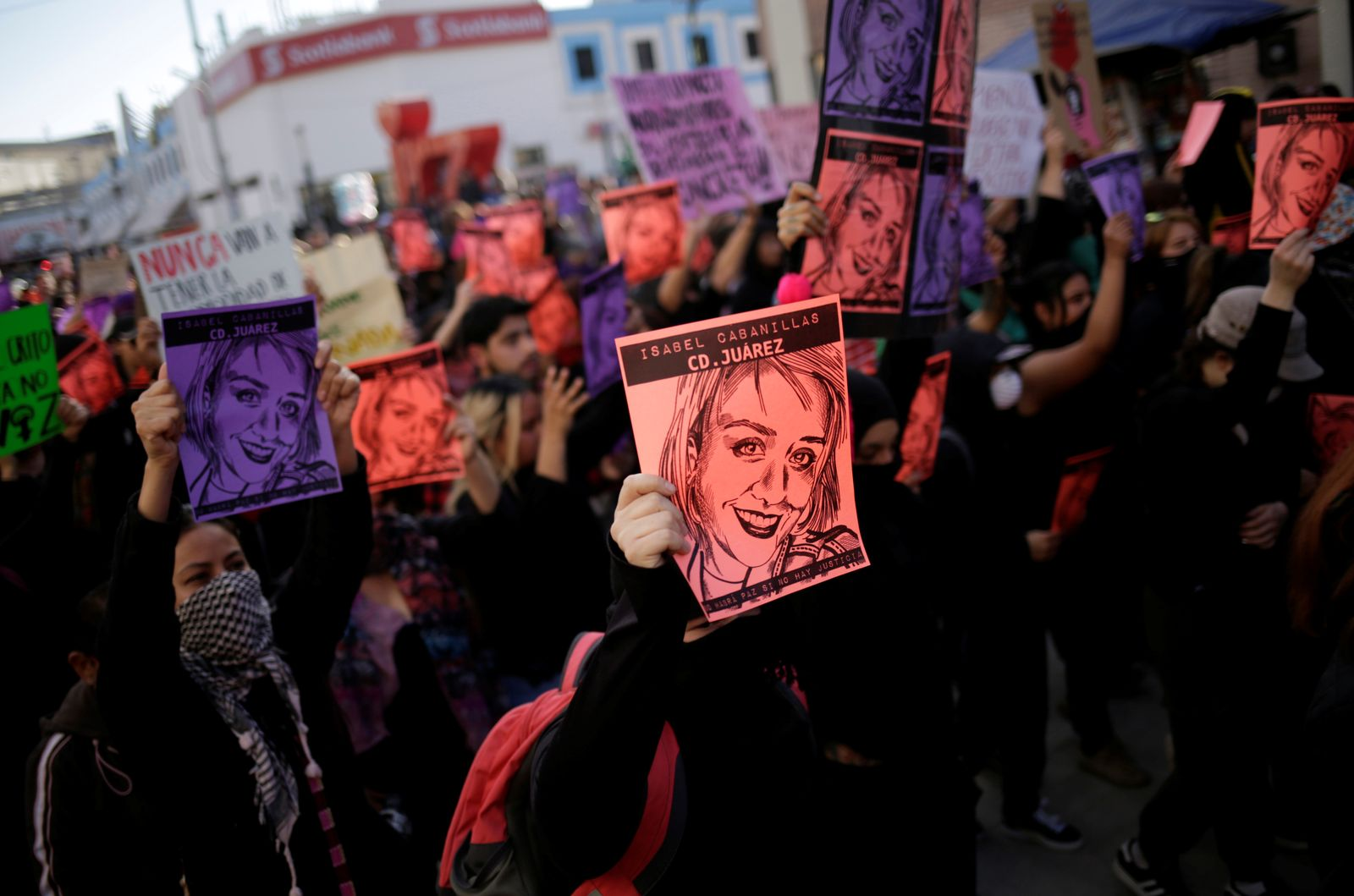 Demonstrators take part in a protest in Ciudad Juarez to demand justice for the murder of Isabel Cabanillas