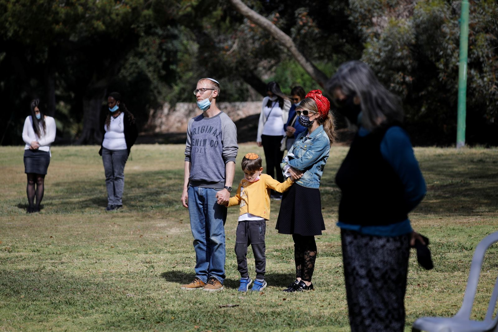 People stand still as a two-minute siren marking the annual Israeli Holocaust Remembrance Day is heard in Ashkelon