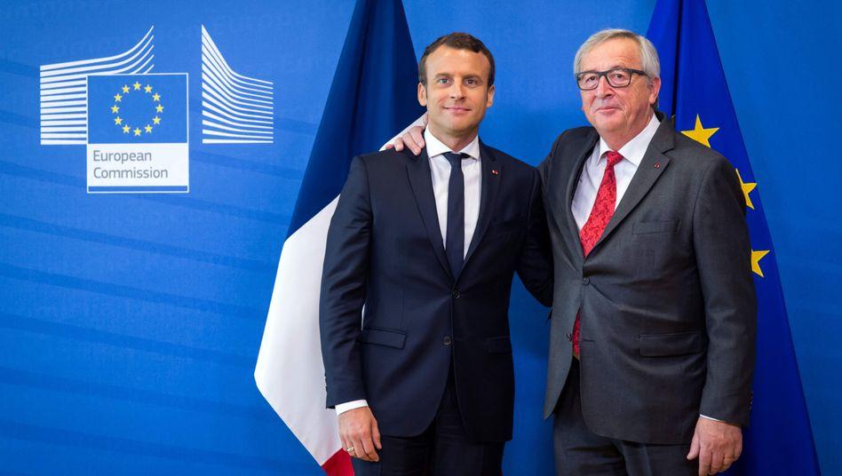 French President Emmanuel Macron and European Commission President Jean-Claude Juncker