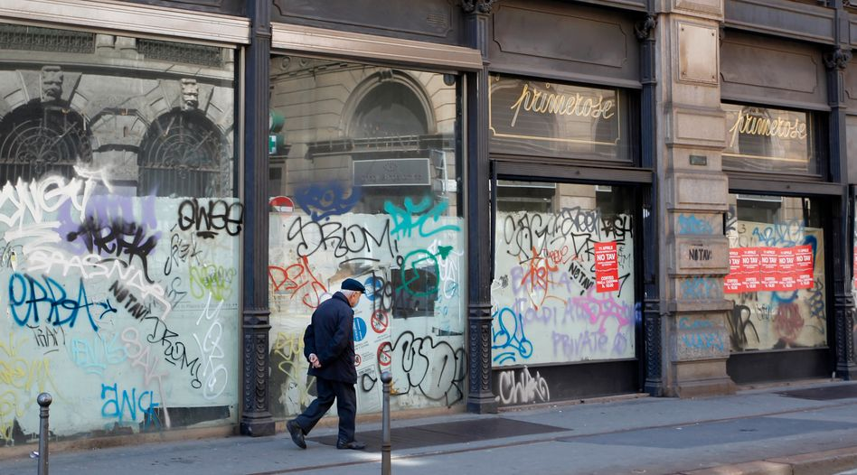 A closed shop in downtown Milan: Italy is in the middle of a recession.