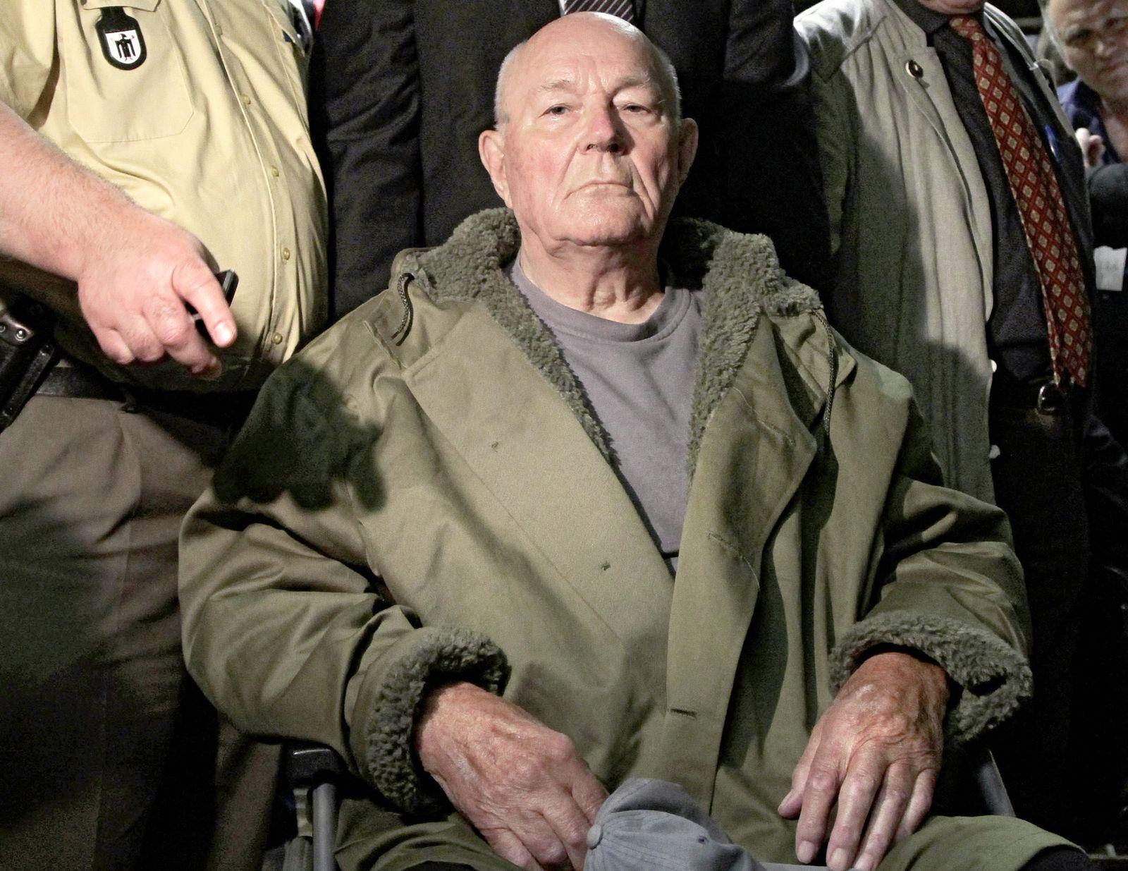 John Demjanjuk emerges from a Munich court